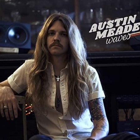 Austin Meade waves